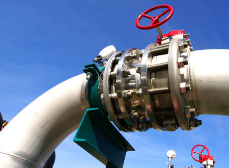 steam turbine: Industrial zone, Steel pipelines and valves against blue sky