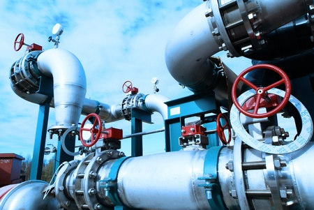 Equipment, cables and piping as found inside of  industrial power plant Stock Photo - 14419404