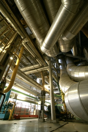 Equipment, cables and piping as found inside of  industrial power plant Stock Photo - 14500550