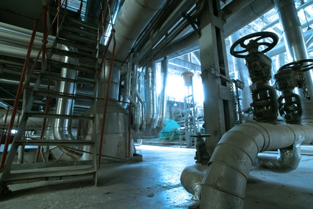 Equipment, cables and piping as found inside of  industrial power plant Stock Photo - 14571817