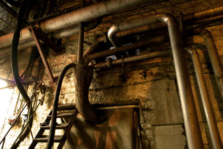 decaying: Old abandoned dirty empty scary factory interior Stock Photo