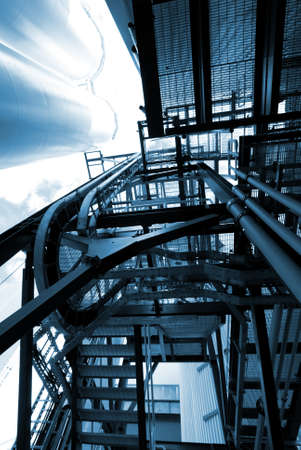 industrial ladders, cables, pipelines in blue tones Stock Photo
