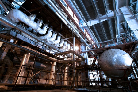 Equipment, cables and piping as found inside of  industrial power plant photo