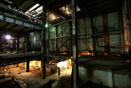 abandoned warehouse: Old creepy, dark, decaying, destructive, dirty factory Stock Photo
