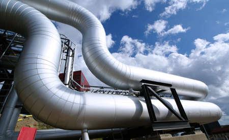 beam pump: Industrial zone, Steel pipelines on blue sky