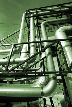 ducts: Industrial zone, Steel pipelines in green tones          Stock Photo