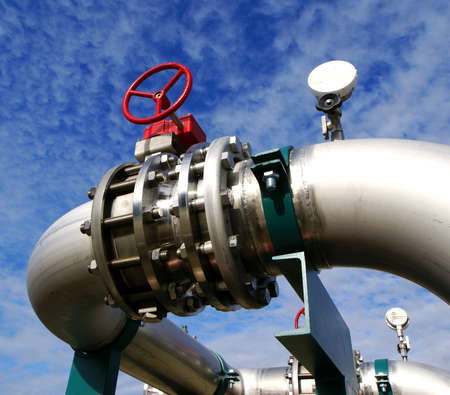oil tool: Industrial zone, Steel pipelines and valves against blue sky