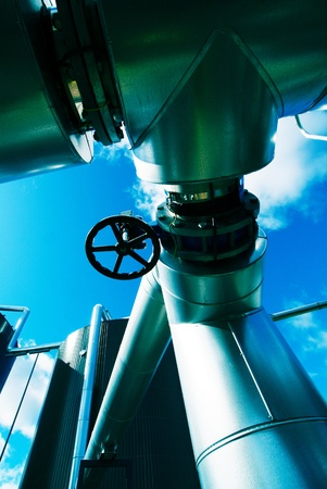 Industrial zone, Steel pipelines and valves against blue sky                Stock Photo - 15730876