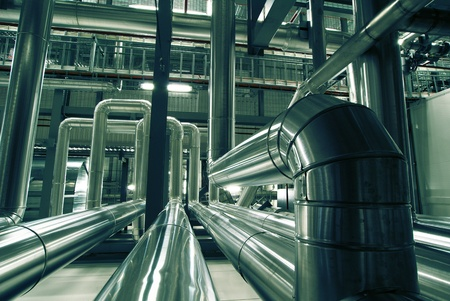 piping: Equipment, cables and piping as found inside of a modern industrial power plant                   Stock Photo