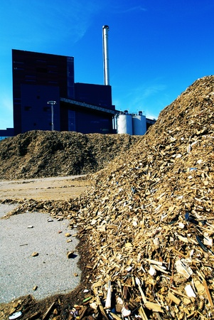 bio power plant with storage of wooden fuel against blue sky Stock Photo - 15952249