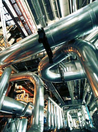 Industrial zone, Steel pipelines in insulation                  Stock Photo