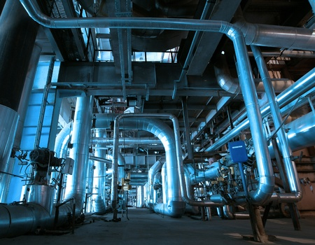 heat radiation: Equipment, cables and piping as found inside of a modern industrial power plant
