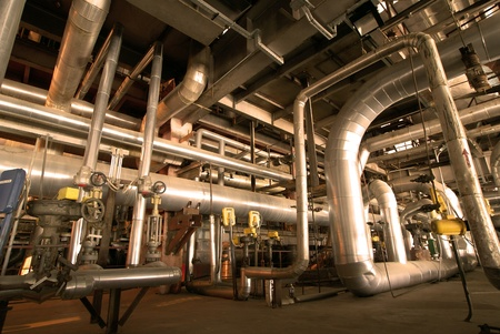 steam turbine: Equipment, cables and piping as found inside of  industrial power plant