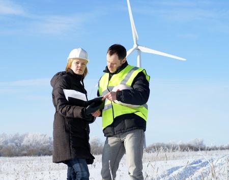 team og engineers with wind turbines photo