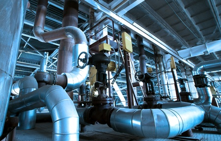 refinery engineer: Industrial zone, Steel pipelines and valves in blue tones Stock Photo