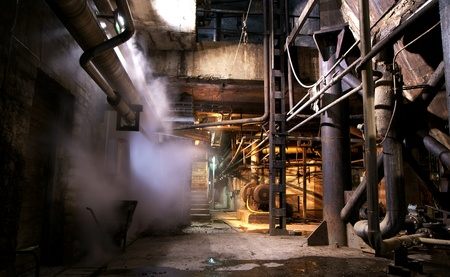industrial ruins: Old creepy, dark, decaying, destructive, dirty factory Stock Photo