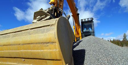 heavy equipment operator: excavator against blue sky