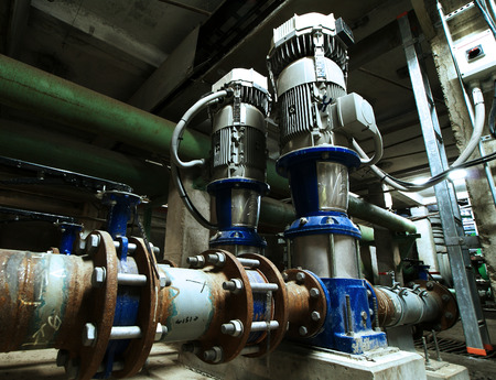 heat radiation: pumps, cables and piping as found inside of  industrial power plant