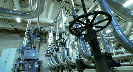 Equipment, cables and piping as found inside of  industrial power plant Stock Photo - 22929963