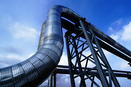 Industrial zone, Steel pipelines and valves against blue sky photo