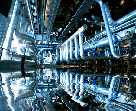 water filter: Industrial zone, Steel pipelines and equipment with reflection Stock Photo