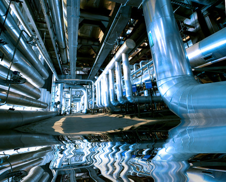 Industrial zone, Steel pipelines and equipment with reflection photo