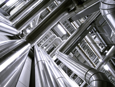 industry: Different size and shaped pipes at industrial plant Stock Photo
