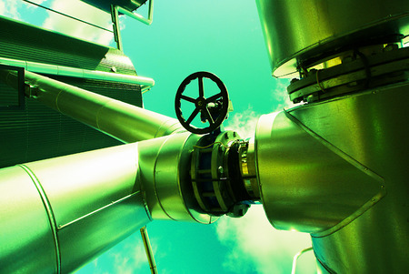 natural gas: Industrial zone, Steel pipelines and equipment in green tone Stock Photo
