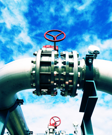 piping: Industrial Steel pipelines and valves  against sky Stock Photo