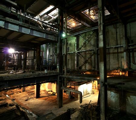 creepy: Old creepy, dark, decaying, destructive, dirty factory Stock Photo