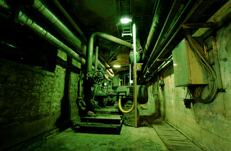 Old abandoned dirty empty scary factory interior photo