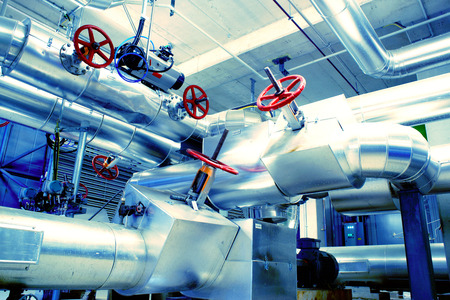 factory line: Equipment, cables and piping as found inside of a modern industrial power plant