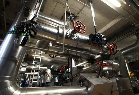 refinery engineer: Equipment, cables and piping as found inside of a modern industrial power plant
