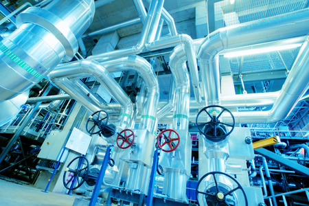 piping: Equipment, cables and piping as found inside of a modern industrial power plant