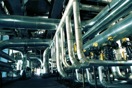 pipe line: Equipment, cables and piping as found inside of a old industrial power plant