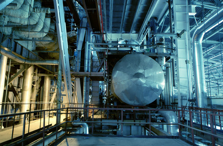 gas industry: Equipment, cables and piping as found inside of a industrial power plant Stock Photo