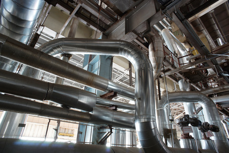 lagging: Equipment, cables and piping as found inside of a industrial power plant Stock Photo
