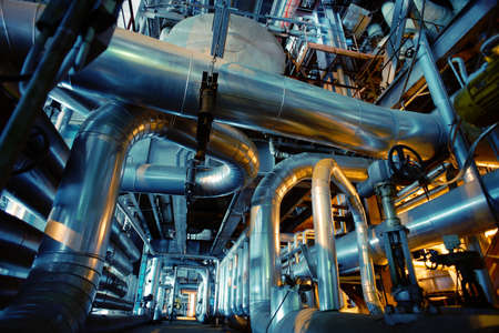 steel industry: Equipment, cables and piping as found inside of a industrial power plant Stock Photo