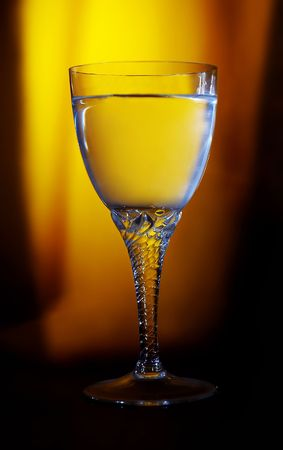 potation: Photo of wine glass with lightning and color Stock Photo