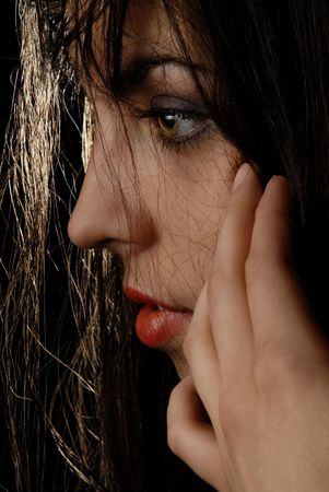 Model in side-face titivates wet hair Stock Photo - 1335321