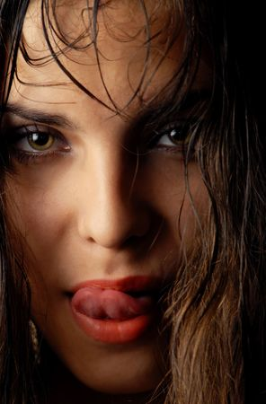 wet lips: Sensual woman moistening her lips with wet hairs