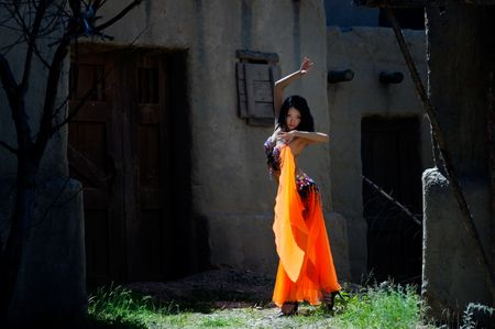 Fashion photo of belly-dancer in national dress dancing in ancient city Stock Photo - 2669668