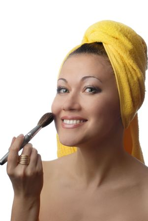 Photo of smiling model with cosmetic brush for skin care photo