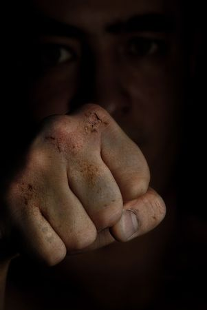 knockdown: Injured fist of boxing fighter as a symbol of hazard Stock Photo