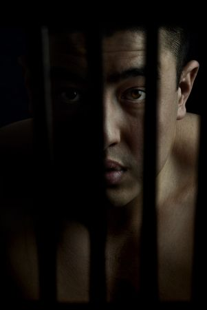 Photo of the man in cage as a symbol of punishment Stock Photo - 2672480