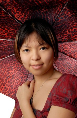 spotty: Cute Asian girl with red spotty fashionable umbrella Stock Photo