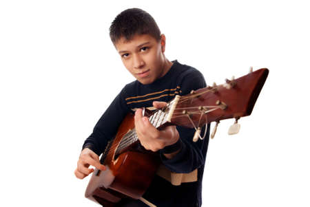 instrumentalist: Studio photo of young boy playng guitare Stock Photo
