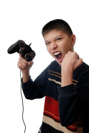 manipulator: Studio photo of boy winning in computer game Stock Photo