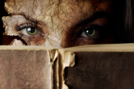 mystery of faith: Conceptual photo of old Bible and cracked face
