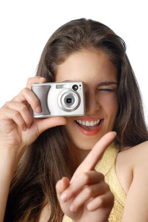 focus shot: Smiling model holding digital camera and making a shot Stock Photo